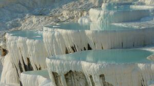 The Water is Super-saturated with Calcium Carbonate forms Travertine - a form of Limestone in Pamukkale Denizli Southwestern Turkey