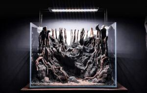Piling up Black Lava Rocks to Raise the Hardscape in a Diorama by Matthew Manes Philippines