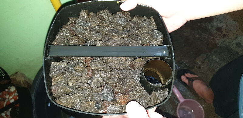 My Canister Filter Tray Stuffed with Black Lava Rocks and Seachem Matrix during Filter Maintenance Keeping it Wet